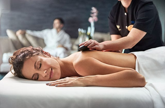 a women laying on her stomach relaxing to one of the lotus spa treatments