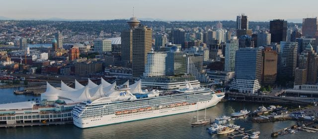 princess cruise ship docked in alaska port with hotels nearby