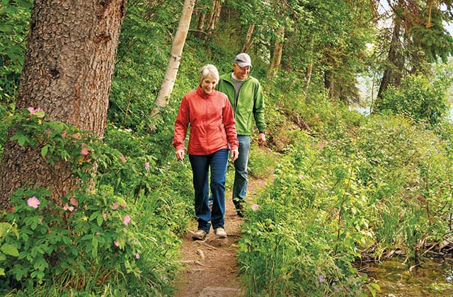 couple waliking on a trail in alaska