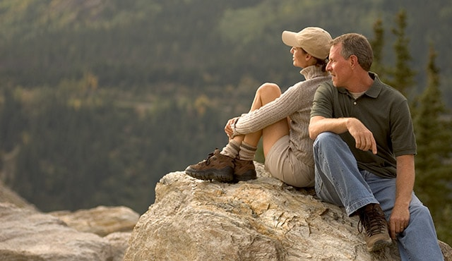 couple sitting on a rock. On your own tours.