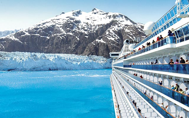 Side of ship sailing by a glacier in Alaska