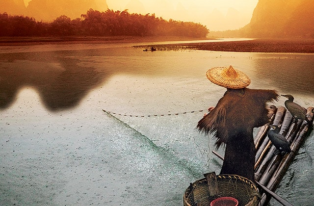 fisherman fishing in southeast Asia