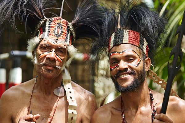 2 Traditional dressed man dancers, Papua New Guinea