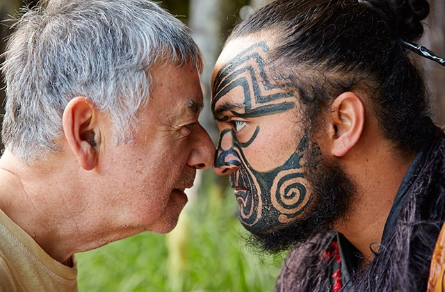 2 men participating in a Traditional Māori welcome