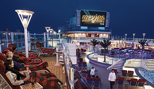 Movies Under the Stars sceen on the top deck with passengers watching