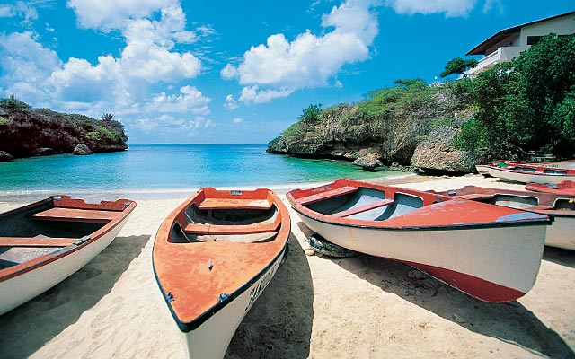 Canoes resting on a beach in the Caribbean