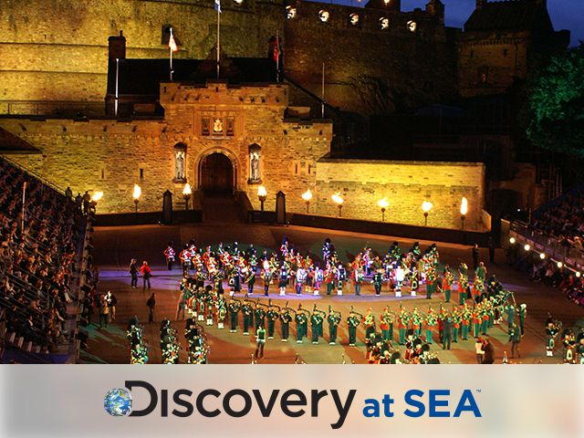 Military Tattoo ceremony at Edinburgh Castle, Scotland with Discovery at logo at the bottom