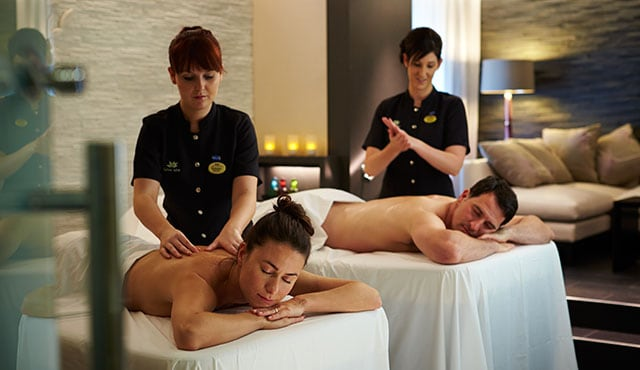 a couple getting a message at the same time in the Lotus Spa