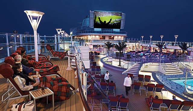 passengers enjoying a football game on the top deck on the Movies Under the Stars® screen