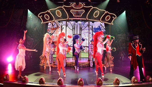 actors in costumes performing a lavish Broadway-style production show