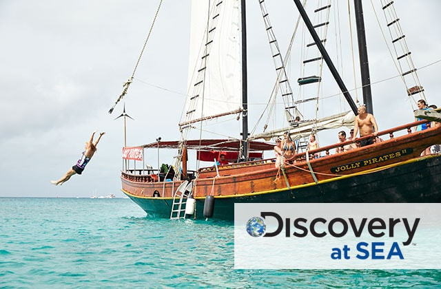 pirate ship at sea with discovery at sea logo