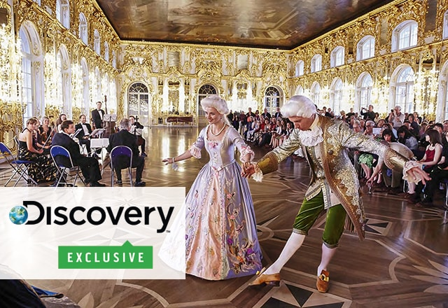 Discovery Exclusive! logo, large crowd enjoying a dance performance at Catherine Palace in St. Petersburg, Russia.