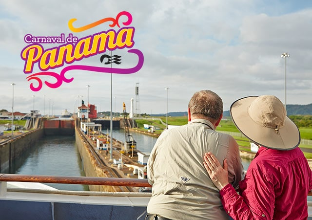 Carnaval de Panama. Man and woman standing on board a Princess ship transiting the Panama Canal