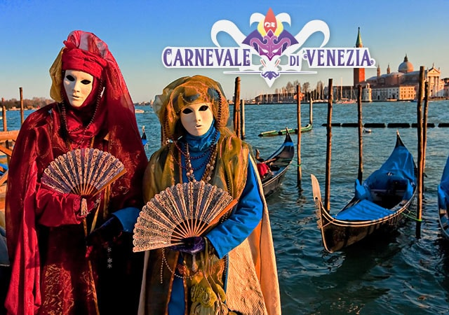 Carnevale Di Venezia. Person in red costume with mask, holding decorative fan, person in yellow and blue costume with mask holding decorative fan with the canals of Venice, Italy in the background