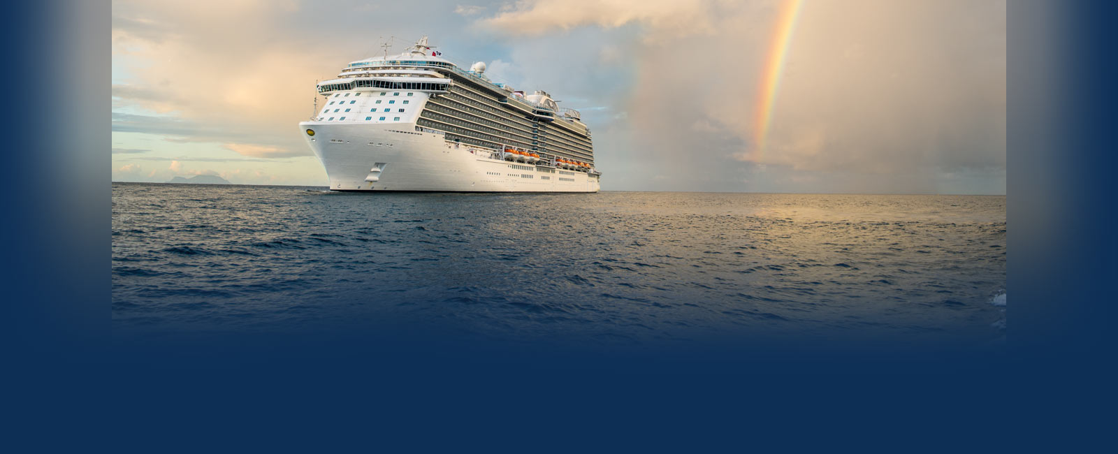 Royal Princess foating on the water with a a rainbow in the background