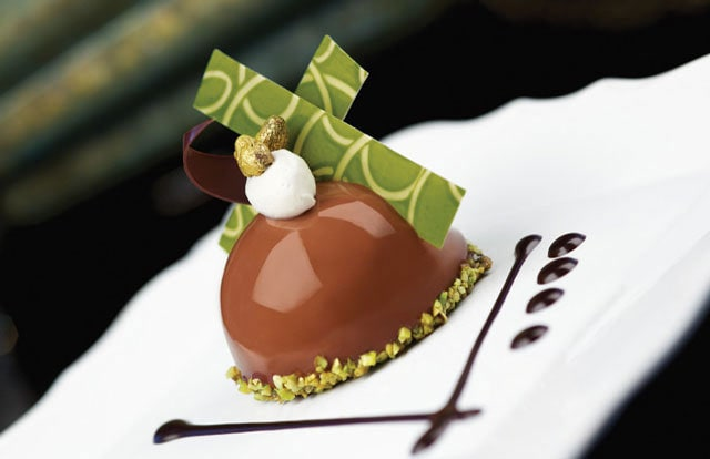 Chocolate pistachio dome with almond and pistachio nougatine