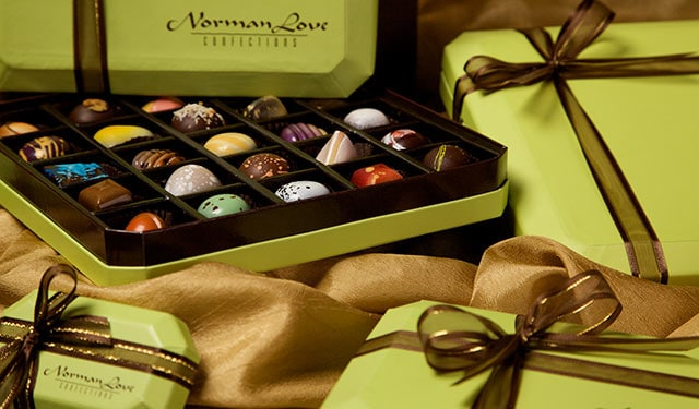 Boxes of Norman Love chocolate candies