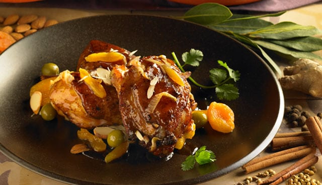 Cornish game hen, garnished with dried fruits and olives