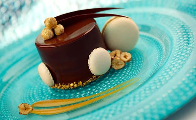 A chocolate dessert by Norman Love, presented on a blue plate