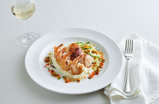 Shrimp and scallop on a bed of mashed potatoes dish