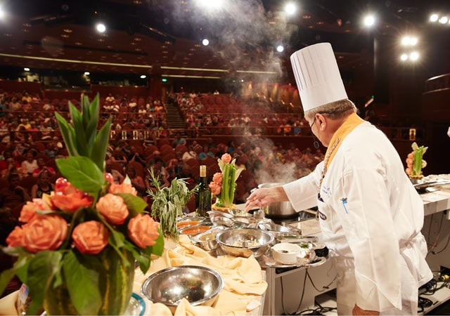 Cooking demonstration by chef in a theatre