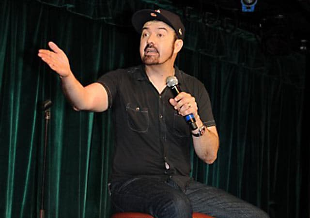 comedian on stage, performing
