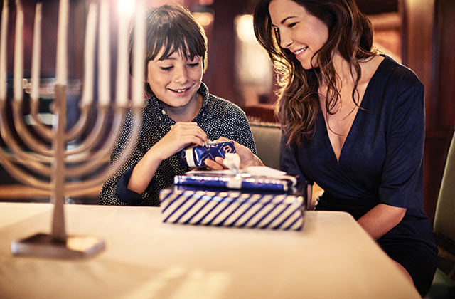 family celebrating Hanukkah onboard a princess ship