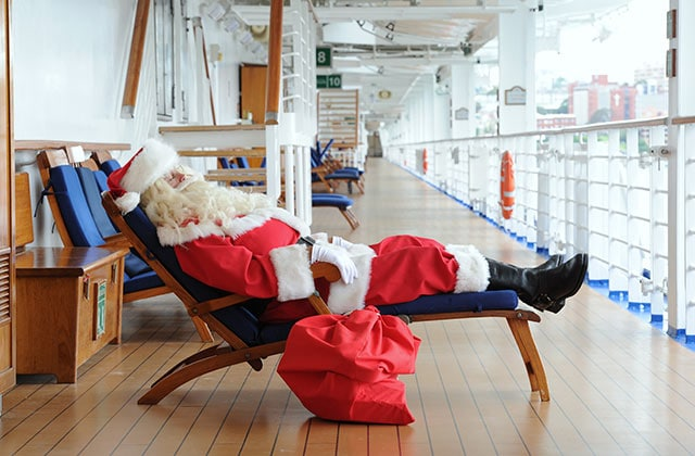 Santa Claus taking a rest on a deck chair onboard a princess ship