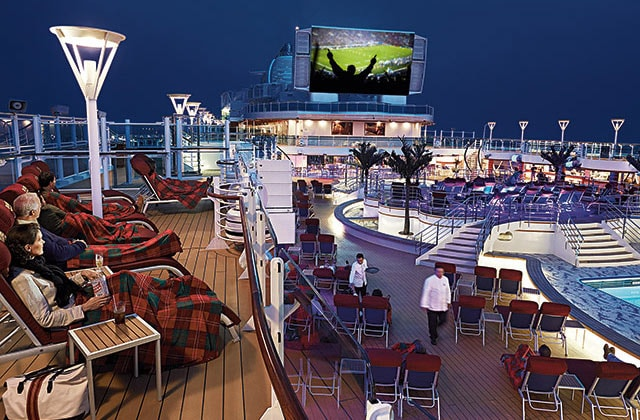 Sports being enjoyed on the large outdoor screen on the top deck