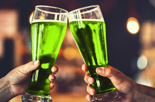 green beer being toasted on St. Patrick's day