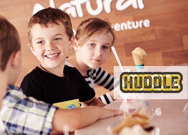Huddle logo; Natural Adventure; girl holding ice cream cone sitting with two boys at ice cream bar
