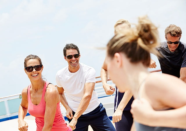 Guests on deck enjoying one of the fitness classes offered onboard a Princess Cruise