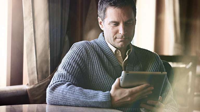 Man reading on a tablet device