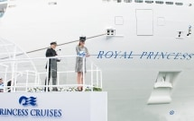 Her Royal Highness The Duchess of Cambridge cuts the ribbon to release the bottle of champagne to officially name Royal Princess